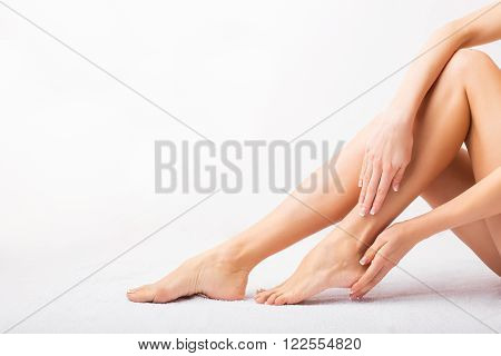 Female taking care of her beautiful legs and feet