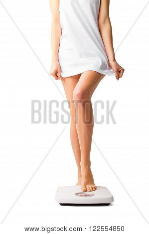 Person standing on weight scale with one leg