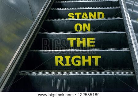 London United Kingdom - March 20 2016: Stand on the right notice on an escalator in London Underground Euston Station