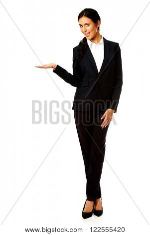 Businesswoman holding copyspace on the left hand