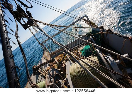 Fishing boat fishing by trawl in coastal waters. Sea of Japan.