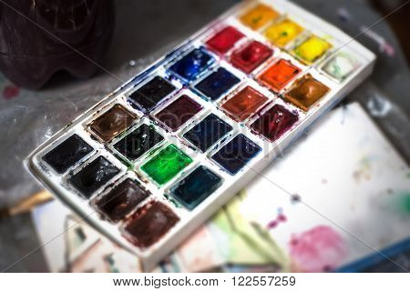 Watercolors on the table of the artist close-up