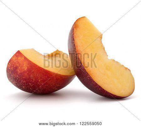 Nectarine fruit slice isolated on white background close up