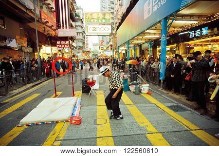 HONG KONG, CHINA - FEB 9: Street performer dancing at the crossroads of the bustling city with crowd of people on February 9, 2016. More than 47 million tourists visit Hong Kong annually