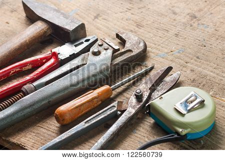 Set of tools for repairs on a wooden surface