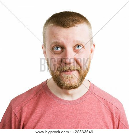 Bearded funny young man in shirt looking up
