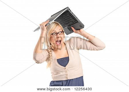 A Scared Female Covering His Head With A Laptop