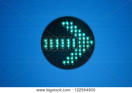 Design of an alight green arrow on vibrant blue background