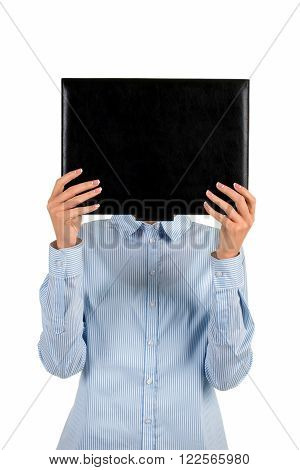 Lady covers face with folder. Businesswoman's face covered with folder. Unidentified female criminal. Subject of investigation.