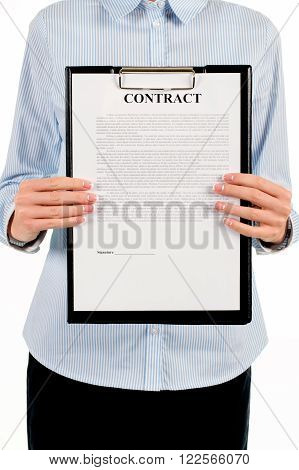 Woman holding clipboard with contract. Businesswoman showing contract on clipboard. Please read this document through. Our conditions are stated here.