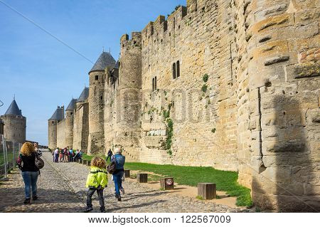 CARCASSONNE FRANCE - MAY 05 2015: Tourists at medieval castle and city of Carcassonne Languedoc-Roussillon France