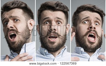 Set of young man's portraits with frightened emotions on gray background