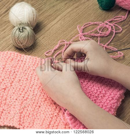 Baby Girl Knitting Pink Scarf Close Up