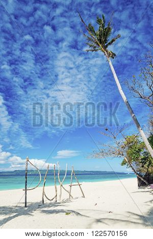 puka beach sign on tropical paradise boracay island philippines