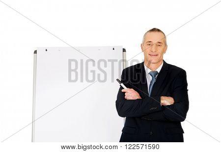 Male executive near flip chart