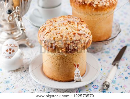 Sweet Easter Bread (Kulich) Topped with Flaked Almonds and Sugar Glaze