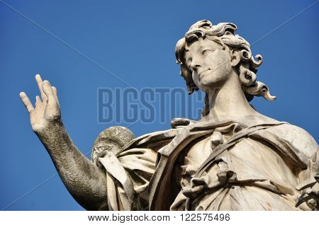 Angel With The Nails. Statue On The Ponte Sant' Angelo Bridge, Rome