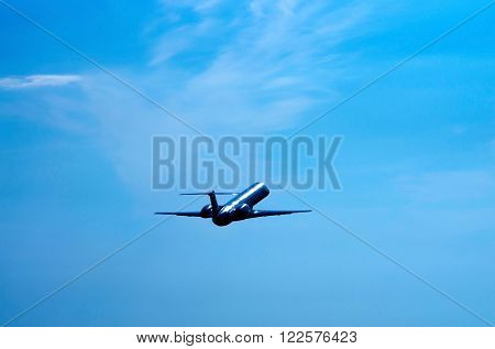 Embraer ERJ 145 silhouette against the sky