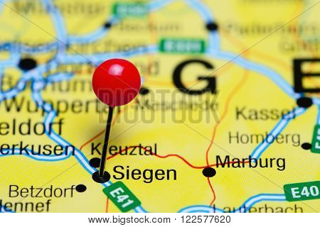 Photo of pinned Siegen on a map of Germany. May be used as illustration for traveling theme.