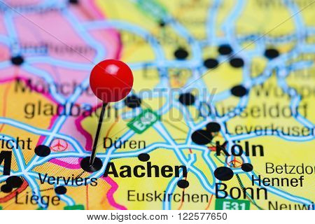 Photo of pinned Aachen on a map of Germany. May be used as illustration for traveling theme.