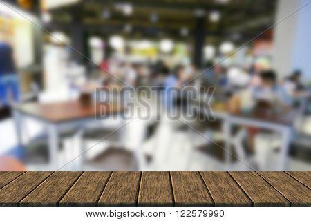 Blurry Defocused Image Of People Eating Food In Food Court