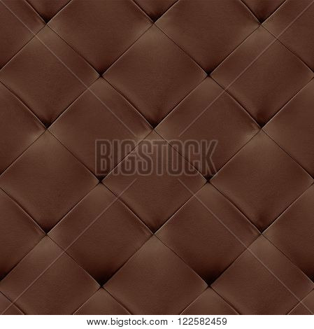 Brown genuine leather upholstery background. Luxury pattern.