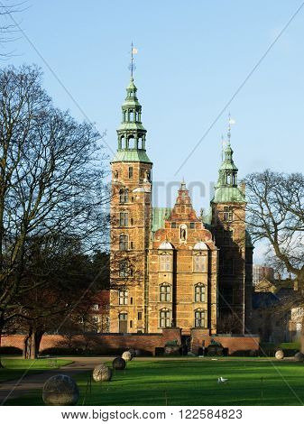 Rosenberg Castle and Stone Balls Alley with Green Grass Early Morning. Copenhagen Denmark