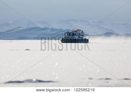 Snow air motion boat goes on big snow field