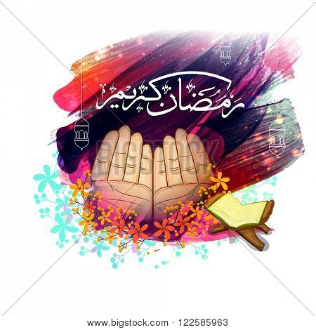 Praying human hands with Arabic Islamic Calligraphy of text Ramadan Kareem and Holy Quran Shareef on colourful paint strokes background.