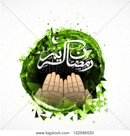 Praying human hands with Arabic Islamic Calligraphy of text Ramadan Kareem on abstract green background for Muslim Community Festival celebration.