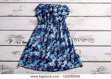 Vintage floral dress without straps. Strapless vintage dress on display. Trend of this summer. Dress with blue floral ornament.