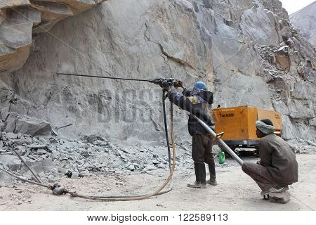 SRINAGAR  LEH ROAD, INDIA - JUNE 11, 2015: Preparation for explosive works on construction of Srinagar Leh road in the Himalayas in Jammu & Kashmir, India
