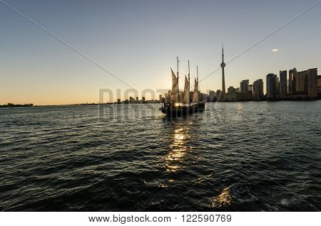 Toronto CA 1st July 2012. Toronto Skyline at Sunset with a saiboat in the foreground
