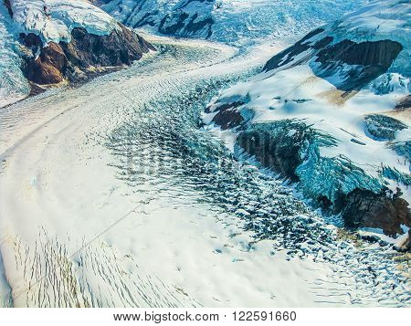 Aerial view of a mountain glacier in the landscape of Denali National Park, Alaska, U.S. .
