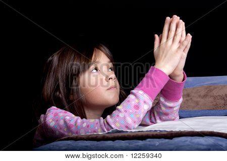 Praying to god at bedtime.