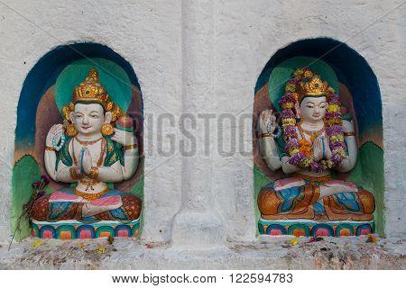 Kathmandu, Nepal - December 03, 2014: Small coloful buddhist statues at Boudhanath Stupa.