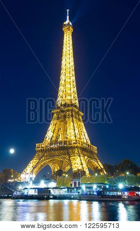 paris; France-October 26 2015 : The Eiffel tower is world known historical and architectural monument located on the bank of the seine river in Paris France.