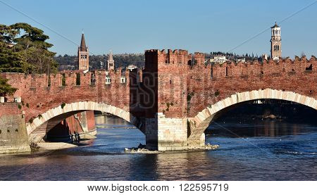 Panorama of Verona with medieval Scaliger Bridge Adige River Tower of Lamberti and belfries of St Eufemia and St Anastasia