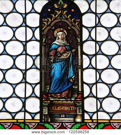 HOHENBERG, GERMANY - MAY 06: Saint Elizabeth, stained glass window in parish church of St. James in Hohenberg, Germany on May 06, 2014.