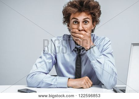 Businessman shocked what happened looking at camera / modern office man at working place depression and crisis concept