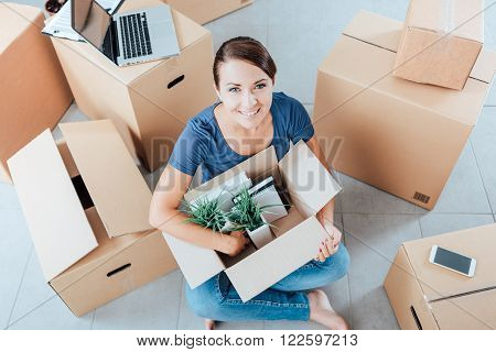 Beautiful Woman Unpacking In Her New House