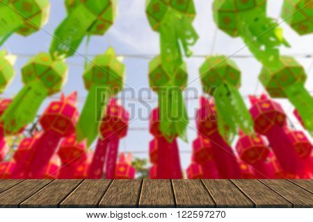 decorating paper lantern in Yeepeng festival which is thailand tradition (blur background with wood table top for display or montage your product)