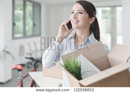 Beautiful Woman On The Phone With An Open Box