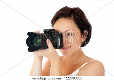 Young girl with DSLR isolated