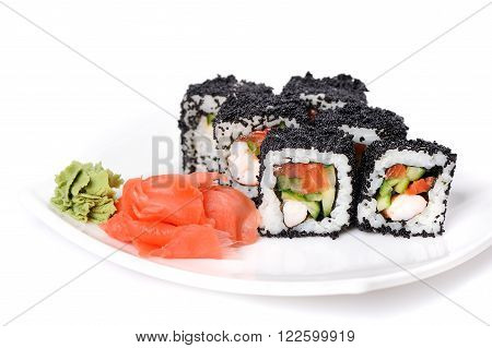 Japan black tobiko rolls with cream cheese and salmon served with wasabi and ginger isolated