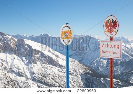 Signs with the coat of arms of free state Bavaria and Tyrol and words