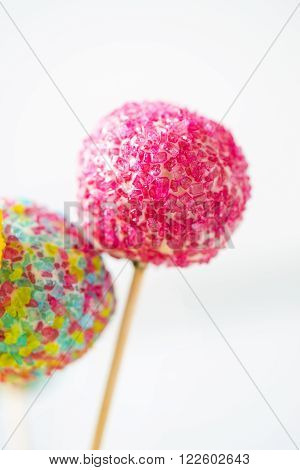Colorful cake pops, little biscuits on a stick