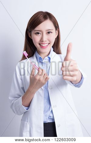 Smile woman dentist doctor teach you brush teeth and thump up. asian