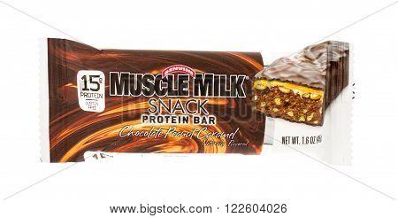 Winneconne, WI - 20 April 2015: Muscle Milk Snack protein bar in chocolate peanut caramel flavor.