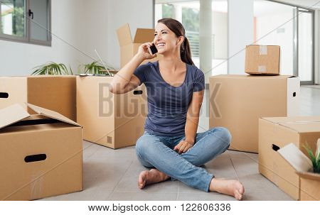 Woman On The Phone In Her New House